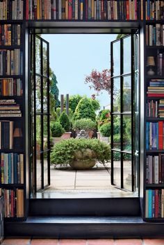 The rooftop garden of a Manhattan penthouse, as seen from the library.