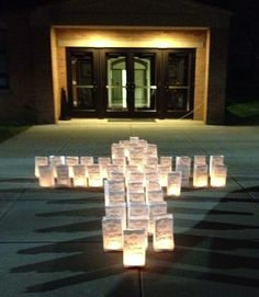 Neat idea to use luminaries in the shape of a cross for an Easter vigil service.