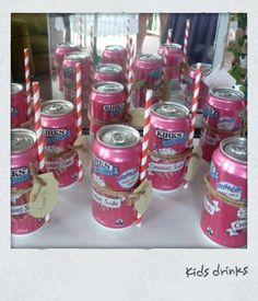 vintage straws  attached to creaming soda cans with twine and names tags