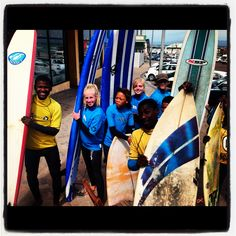 Surfshack Surf Outreach Cape Town kids and our surf volunteers from DTR and  IVHQ getting ready for surf.