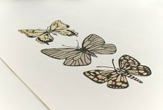 Moths Trio lino print art by Laurie Mitchell