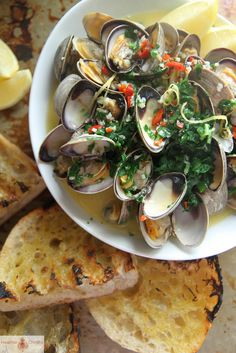 I will tell you what. When you are hungry and strapped for time and you have 2 pounds of clams staring at you from the fridge, there is only one thing to do, right? Steam them in a bog pot with butter and wine. Don't you think? And then toast some rustic bread with olive …