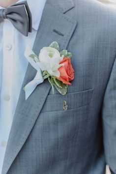 #roses #boutonniere #ranunculus Photography by forevercandid.com Floral Design by facebook.com/designbylaurajean  Read more - http://www.stylemepretty.com/2013/03/21/machester-by-the-sea-wedding-from-forevercandid-photography/
