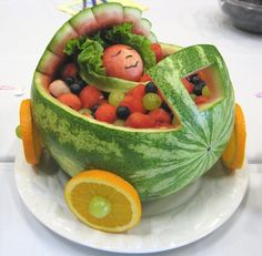 Fresh fruit makes a frightfully festive (and healthy) Halloween dessert. Baby Shower Watermelon Carriage watermelon baby--how cute for Baby . Baby Shower Fruit, Baby Shower Watermelon, Watermelon Art, Watermelon Carving, Watermelon Basket, Baby Fruit, Watermelon Centerpiece, Carved Watermelon, Watermelon Designs