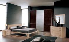 Bedroom: Small Modern 3D Bedroom Layout Ideas For Square Rooms With Varnished Wooden Floor Modern Tv Wall Mount Unit Design Grey Bed Sheet Over Black Bed Cover Wooden L Shaped Bedside Table from 5 Tips for Your Bedroom Furniture Arrangement
