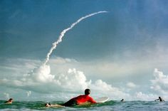 Cocoa Beach surfers watch Atlantis' launch on September 8, 2000.
