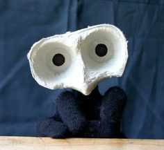 Wall-E made out of an egg carton, unfortunately the site is in Russian, but you get the idea
