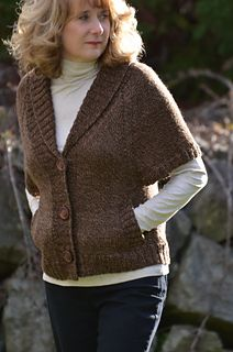 Eyelet V-Cardigan. ravelry.com knitted in one piece from the bottom up separating for the sleeves and knitting the back and fronts separately from the underarm up. Pockets can be knit in or eliminated upon each individual preference. Sleeves are set apart with eyelets.