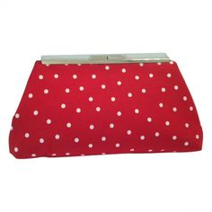 "Red White Polka Dot (M)..........White polka dots on a red background adorn this clutch. The purse is lined with black cotton and finished with french seams. The frame is a silver finish with chain clips to add a convenient carrying chain. (Chain sold separately.) Dimensions are approximately 10 1/2"" wide by 5 1/2"" high x 2"" deep. #picoftheday #colorful #purse 9thelm.com"