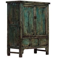 Chinese Blue Lacquer Cabinet. This handsome antique cabinet orignated in Shanxi province in central China in the early 20th century. It has been refinished in a distressed blue lacquer, giving it a new look that would fit well in a contemporary setting. #AntiqueCabinet #BlueLacquerCabinet