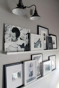 Photo Ledges O Fun - love the mixture of canvas with framed art and photos...for the catwalk? by SeriLynn