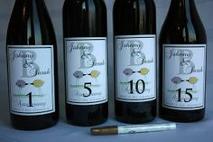 Wine bottle guest books can include personalized labels on each wine bottle that correspond to anniversary years.