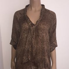 Leopard Print Blouse from NY & Co New York and Company XL Top in Leopard Print. Has a tie in the front as seen in the pictures. Lovely detail on the 3/4 sleeves. Small band around bottom of blouse. Good condition. Smoke free home. New York & Company Tops Blouses