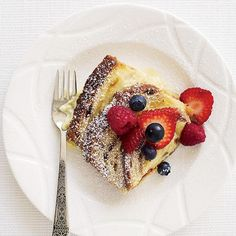 Cinnamon-Raisin Bread Custard with Fresh Berries | Chef Bradley Ogden's 1987 recipe for ultrarich bread pudding is perfect for dessert or brunch. It can be made with store-bought bread, but it's best made with a fresh bakery loaf, sliced 1/2 inch thick.