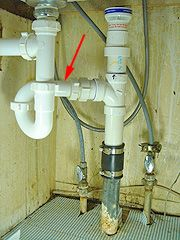 P-trap installed between sink drain and vertical drain line. | Ideas on air vent bathroom sink, vent under stove, vent under shower, vent under toilet, ways to vent a sink, vent under fireplace, vent under sink pump installation, vent under vanity, plumbing pipe under sink, vent under cabinets, vent under furniture, vent under bed,