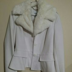 Bebe faux fur collar white jacket Bebe White jacket with faux fur removable collar & peplum style bottom. Only worn a few times. Newly dry cleaned bebe Jackets & Coats