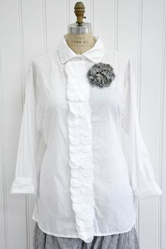 """Features:    Beautiful yet professional top   Side ties   Funraw edge button placket detail   100% Cotton Voile, White   Fits sizes 2-20   Measurements:    Chest: about 53"""" around   Length: about 30"""" long"""