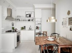 white kitchen with chunky wood table - LU2 http://www.planete-deco.fr/page/20/