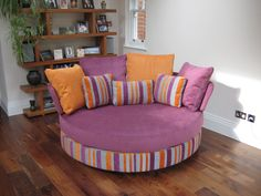 This snuggler sofa/loveseat may be purchased with a static base or a swivel base. Measures 175 cm wide x 130 cm this is an excellent alternative to a small sofa and much more fun!