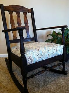 Mom-similar style to this. only difference is the arms are upholstered as well. (the back style is a little different)