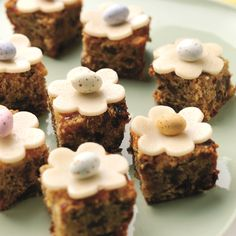 A twist on the traditional Easter simnel cake. Bake this Mini Simnel Cakes Recipe as a tray bake and children of all ages will enjoy decorating them.
