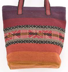 Peruvian Tote Bag: This tote is a rainbow of woven stripes; the colors derived from flowers, roots, insect, and bark. The center pattern is a special motif from the Chinchero CTTC cooperative in the Peruvians Highlands of Cusco. | Clothroads