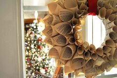 Learn how to make a book page wreath. I think a cute idea for the Holidays would be to print old Christmas Music to make the wreath. You could also add a bow to the ribbon if you wanted a different look.