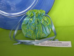 "#Jewelry Pouch.  This is a gorgeous pouch.  Individual compartments inside the pouch separate and protect your jewelry while you travel.  $8.99 via www.IslandJewelryBags.etsy.com  ""WaterFall Mist"""
