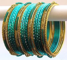 Aqua Green Poth Beads Indian Bangles Bracelets Set Product Code :Indian Bangles Set 6 The Bangles Set Contains 24 individual Bangles Colors & Design: (As Per Images) Quantity: 1 Bangles Set Base Material : Alloy Metal and Age Group : Adult,Kids Price $USD   7.99