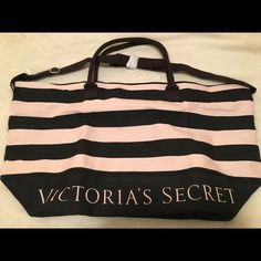 """Victoria's Secret Duffle Bag Pink and black duffle bag NWT never used. 23.5""""x13.5"""" with extra storage in the bottom with zipper. Adjustable shoulder strap. Victoria's Secret Bags Travel Bags"""