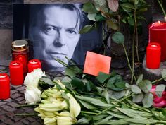 Flowers and lit candles are pictured next to a portrait of David Bowie outside the apartment house where he was living in 1976-78 in Berlin's Schoeneberg district, Germany, January 11, 2016. Bowie, a music legend who used daringly androgynous displays of sexuality and glittering costumes to frame legendary rock hits Ziggy Stardust and Space Oddity, has died of cancer.