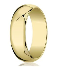 A classically elegant look reaches new heights in this men's designer gold wedding band. Peerless 10K yellow gold is formed into a shining 7mm band with a traditional fit and domed profile. This men's gold wedding ring is sure to attract many an admiring glance. Web Page:   http://www.justmensrings.com/Designer-7-mm-Traditional-Domed-Polished-Finish-10K-Yellow-Gold-Wedding-Band--JB1086_p_105.html