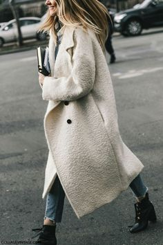 A classic white overcoat is a must for the winter.