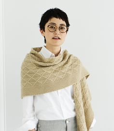 A crescent-shaped shawl with beautiful diamond patterns, knit with cables. The border on the edge is knit in garter stitch. A large piece, the shawl drapes beautifully. Knit in Woolfolk Får, it will wrap your shoulders like a dream.