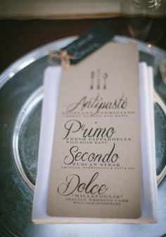 The menus at each place setting. Love it in Italian! More then half the guests will be able to read it so that's good enough lol