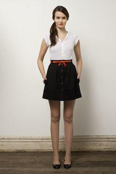 I like the orange detail on the skirt.