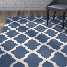 Anchor your living room seating group or define space in the den with this artfully hand-tufted wool and cotton rug, featuring a trellis motif for eye-catching appeal. Blue And White Rug, Blue Ivory, Navy Blue, Furniture Design For Hall, Furniture Village, Home Rugs, Ivoire, Blue Area Rugs, Decoration