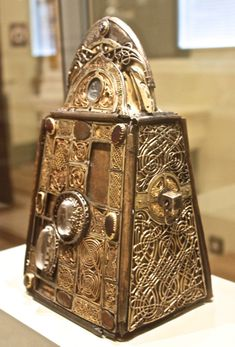 The Bell of St. Patrick and its Shrine. Armagh, Ireland. 8th-9th century AD. This bell is reputed to have belonged to St. Patrick. It is made of two sheets of iron which are riveted together and coated with bronze...