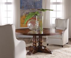 This round French Provencial dining table has detailed carvings and tabletop finish embraced in a warm, rich finish.