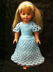 This is a free download from Ravelry: Pearly Dress and Headband for 18 in. Doll pattern by Pro-Bee Crochet