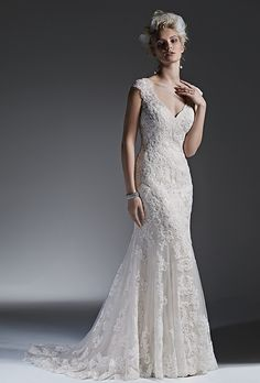 Sottero & Midgley. See more details from Sottero & Midgley��Beaded lace appliqu�s adorn tulle in this stunning modified A-line wedding dress with a romantic keyhole back. Finished with covered buttons over zipper closure.