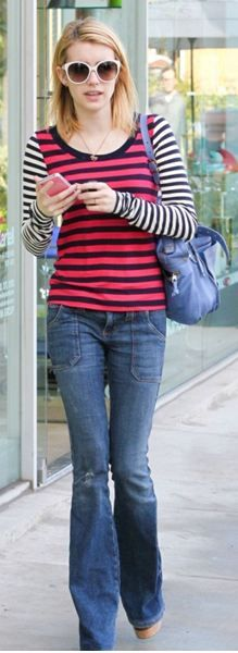 Who made Emma Roberts' blue handbag, blue jeans, and stripe long sleeve tee that she wore in Los Angeles on January 24, 2012?