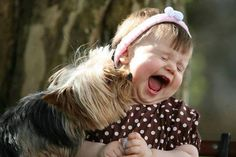 oh joy!  Which one makes you smile the most, the puppy licking her face, or the little girl's laughter?  Both!