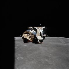 Apollo 16 Re-Docks With the Command Module (23 April 1972) — The ascent stage of the Apollo 16 Lunar Module (LM) approaches the Command and Service Modules (CSM) during rendezvous, with a contrasting background of darkness and the moon's Sea of Fertility (Mare Fecundatatis). Taken from the CSM, the photo shows the aft side of the LM during a yaw maneuver. Note the buckled thermal panels. Messier and Messier A (right center) are among the most readily identifiable features on the surface