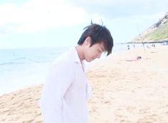 Hae in an unbuttoned white shirt