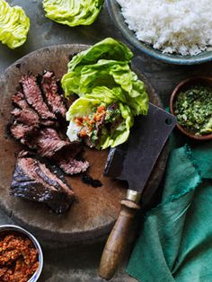 Korean-style barbecued skirt steak ssäm with ginger and spring onion sauce.