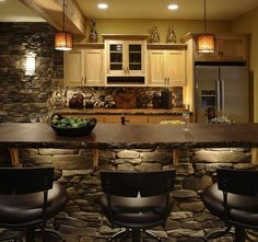 rustic kitchen iterior stained concrete countertop decorative stone wall wood cabinets