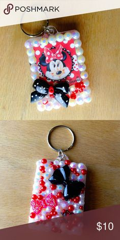 "🆕 Minnie Mouse Key Chain / Purse Charm Handmade key chain with assorted pearls and stones finished with a Minnie Mouse charm.  We offer 15% off on all bundles. You can ""Add to Bundle"" to get discount.  Most items listed are ready to ship but if you need something sooner please let us know before ordering.  Thank you for shopping my closet! Magic Main Street Accessories Key & Card Holders"