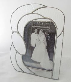 Clear Texture Hand Crafted Stained Glass table top picture frame by JiSTglass, $58.00. A wonderful wedding gift that comes complete with a wedding photo...  my parents who will be celebrating 60 years together in August!