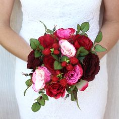 Looking for red wedding flowers? Check out this gorgeous red and pink silk rose wedding bouquet with faux strawberry accents. A beautiful mix of reds and pinks, this rich rose bridal bouquet is perfec